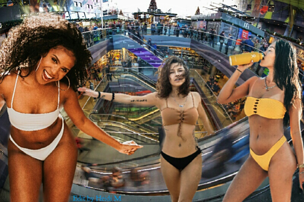An edit - 3 girls in bikinis dancing and drinking, in an indoor multi level shopping plaza.