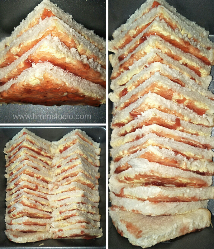 Bread and butter pudding in triangles placed in oven tray.