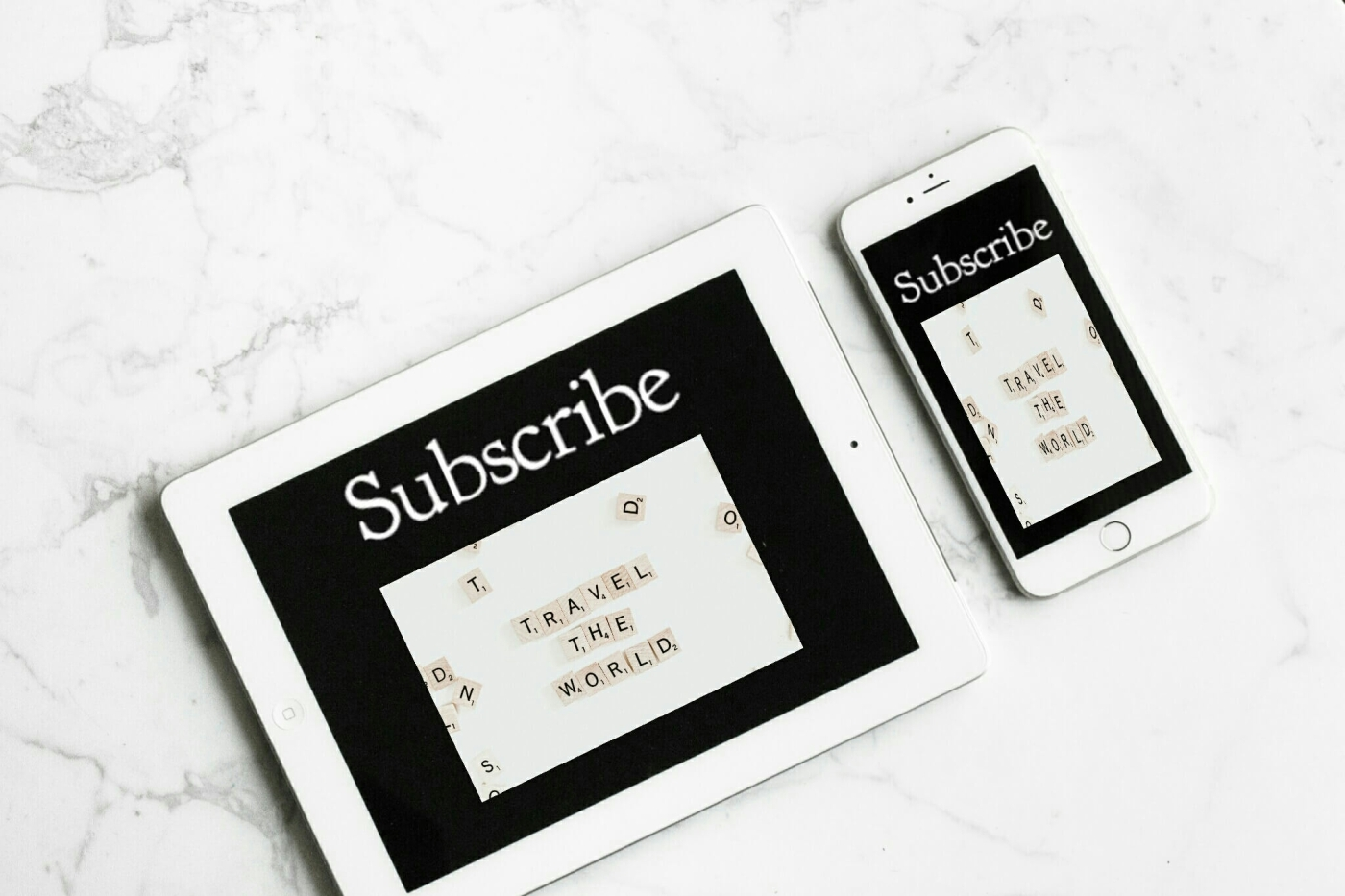 An iPad and iPhone with subscribe on their displays.