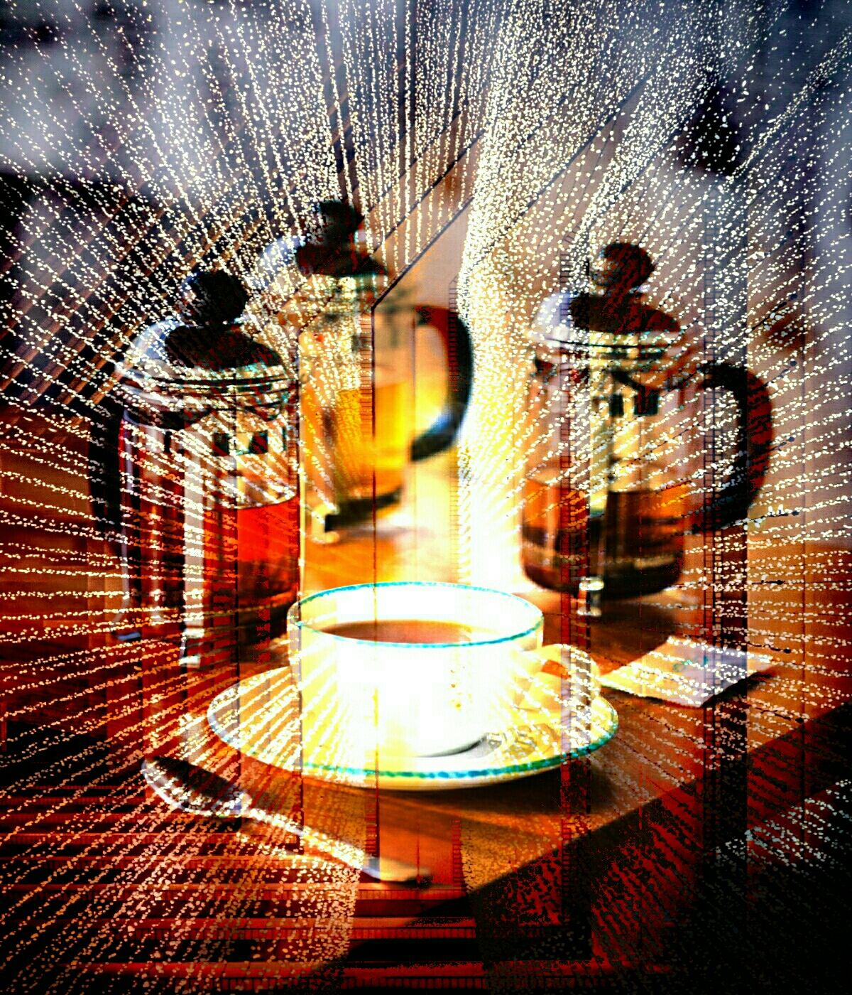 3 Plunger tea pots with a teacup and saucer with multiple light streams surrounding them.